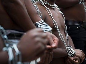 Eritrean migrants wear chains to mimic slaves at a demonstration against Israel's planned expulsion of asylum seekers, Jerusalem, January 17, 2018.