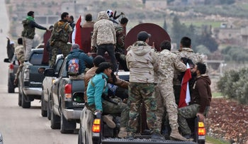 A convoy of pro-Syrian government fighters arriving in Syria's northern region of Afrin, February 20, 2018.