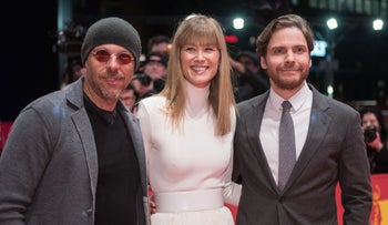 """""""7 Days in Entebbe"""" director José Padilha, and stars Rosamund Pike and Daniel Brühl at the film's world premiere in Berlin, February 19, 2018."""