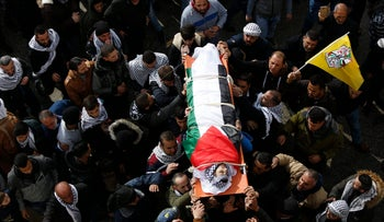 Palestinians mourners carry the body of Hamza Zamareh, who was killed after he stabbed an Israeli security guard, Halhul, West Bank, February 17, 2018.