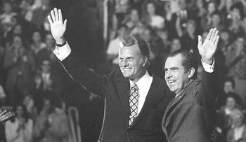 In this Oct. 16, 1971 file photo, Evangelist Billy Graham and President Nixon wave to a crowd of 12,500 at ceremonies honoring Graham at Charlotte, N.C.   Graham, who transformed American religious life through his preaching and activism, becoming a counselor to presidents and the most widely heard Christian evangelist in history, has died
