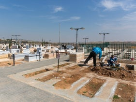 Laborers working at the Mishor Adumim settlement cemetery in the West Bank.