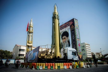 A display featuring missiles and a portrait of Iran's Supreme Leader Ayatollah Ali Khamenei is seen at Baharestan Square in Tehran, Iran. September 27, 2017