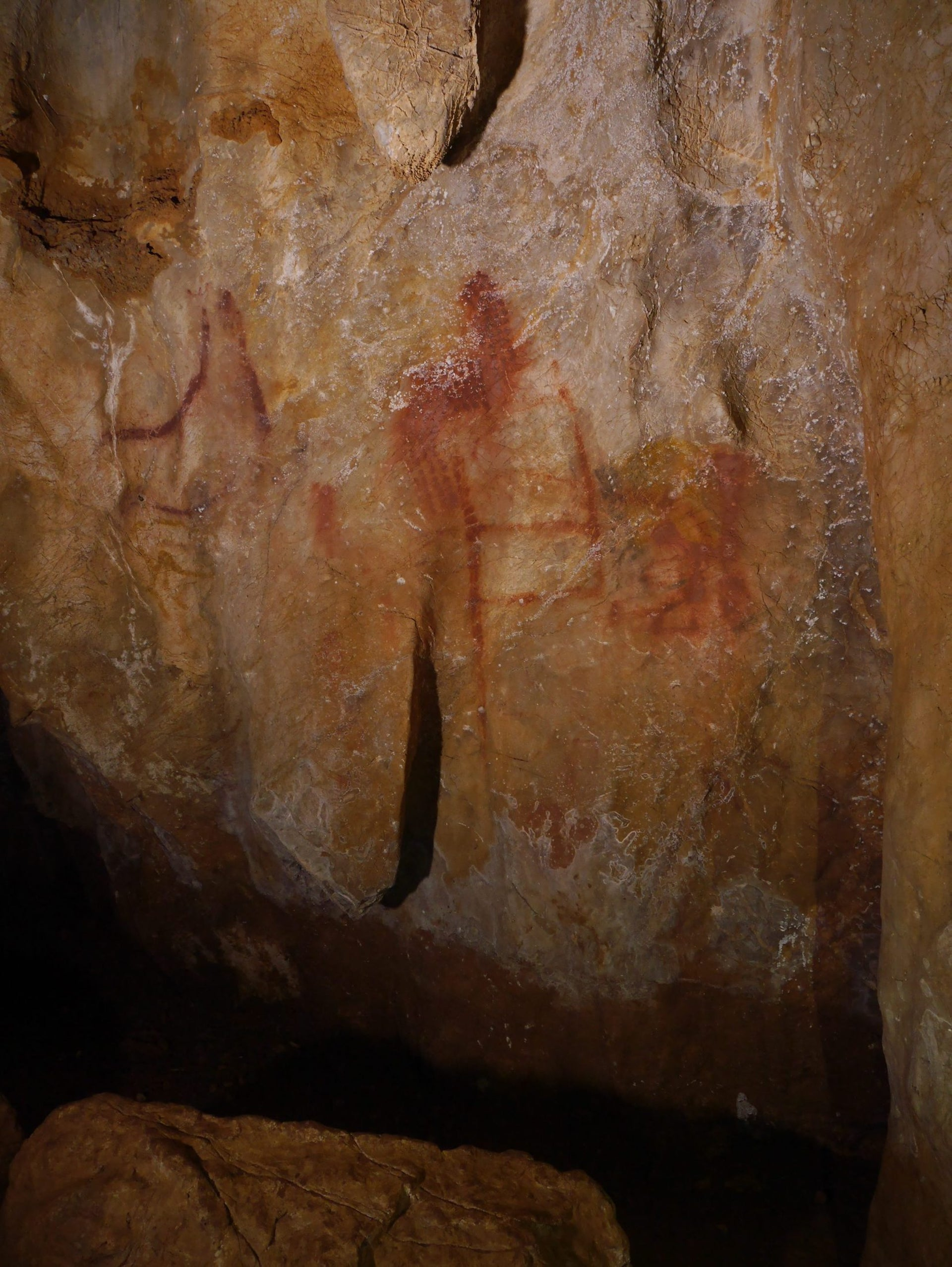La Pasiega. The scalariform (ladder shape) composed of red horizontal and vertical lines dates to older than 64,000 years and was made by Neanderthals.