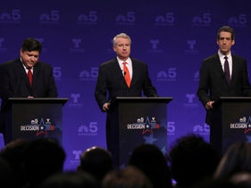 Democrats running for Illinois governor from left, J.B. Pritzker, Chris Kennedy and Daniel Biss take their podium positions before a televised forum in Chicago, January 23, 2018.