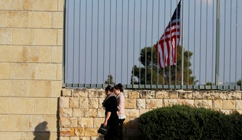 People walk past the U.S. consulate in Jerusalem February 24, 2018.