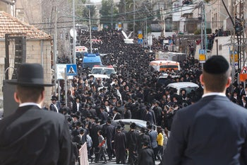 Ultra-Orthodox Jewish men mourn during the funeral of Rabbi Shmuel Auerbach, head of an ultra-Orthodox Jewish denomination known as the Jerusalem Faction, in Jerusalem, February 25, 2018.