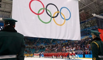 Olympic Athletes from Russia wear their gold medals under the Olympic flag during the victory ceremony. REUTERS/Kim Kyung-Hoon