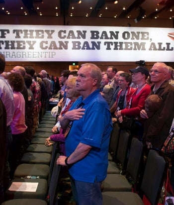 Attendees stand for the national anthem at the 144th National Rifle Association (NRA) Annual Meeting. Nashville, Tennessee, U.S., April 10, 2015