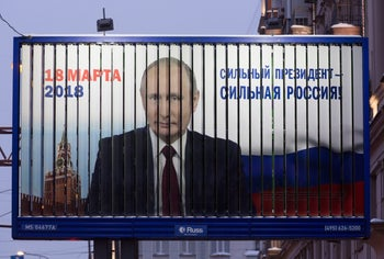 A billboard poster featuring incumbent Russian President Vladimir Putin in Moscow, Russia, on February 20, 2018. Voting in the first round of the 2018 Russian presidential election takes place on March 18.