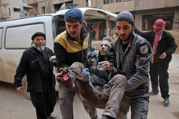 A wounded man being carried into a makeshift hospital in the rebel-held town of Douma, following airstrikes on Eastern Ghouta, on the outskirts of Damascus, Syria, February 20, 2018.