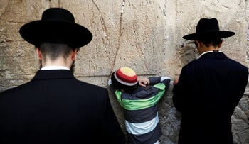 Jews praying at the the Western Wall in Jerusalem's Old City, December 28, 2017.