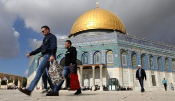 Worshipers walk around before Friday prayers on the compound of the Temple Mount in Jerusalem's Old City.