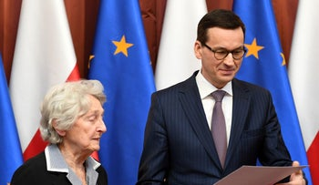 Polish Prime Minister Mateusz Morawiecki reads a letter signed by fifty Poles recognized by Yad Vashem for saving Jews during the Holocaust on February 26, 2018.