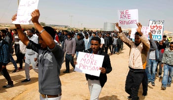 African asylum seekers march from Holot to the Saharonim Prison in the Negev desert on February 22, 2018.