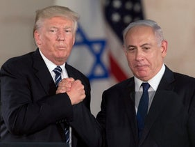 U.S. President Donald Trump, left, shakes hands with Israeli Prime Minister Benjamin Netanyahu at the Israel Museum in Jerusalem, during his visit in May 2017.