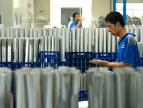 File photo: Employees work near aluminum tubing at the Giant Manufacturing Co. Ltd. factory in Suzhou, Jiangsu Province, China on Wednesday in August 2015.