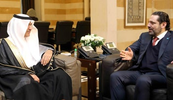 A handout picture provided by the Lebanese photo agency Dalati and Nohra shows Lebanese Prime Minister Saad Hariri meeting with head of the Saudi envoy Nizar al-Alula at the governmental palace in the capital Beirut, on February 26, 2018.
