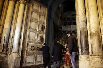 Christian clerics reopening the doors of the Church of the Holy Sepulchre in Jerusalem, February 28, 2018.