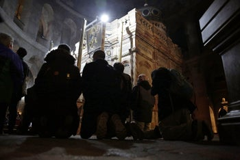 Visitors praying inside the Church of the Holy Sepulchre in Jerusalem, February 28, 2018.