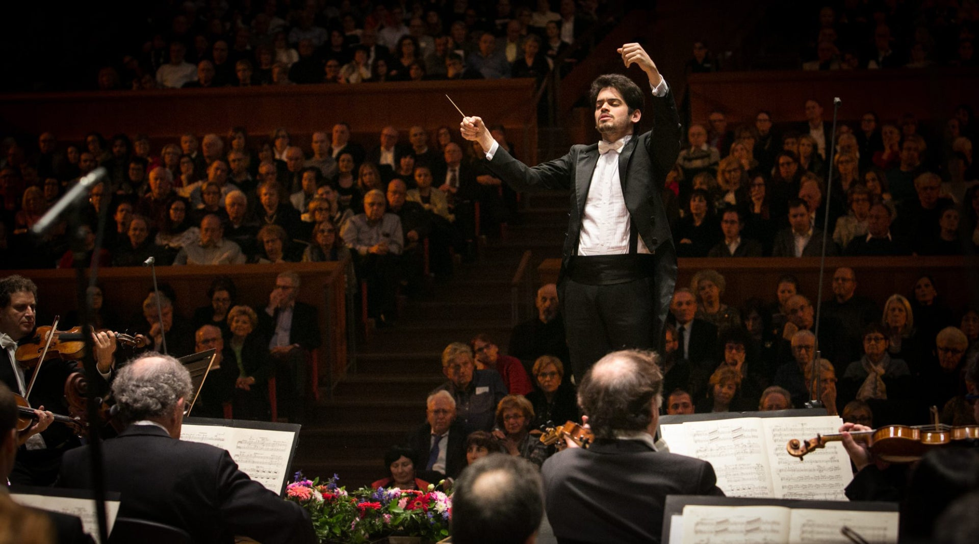 Lahav Shani conducting the Israel Philharmonic Orchestra at its 80th anniversary concert, 2016.
