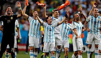 Argentina's Lionel Messi and teammates celebrate at the end of the World Cup quarterfinal soccer match between Argentina and Belgium at the Estadio Nacional in Brasilia, Brazil, Saturday, July 5, 2014.