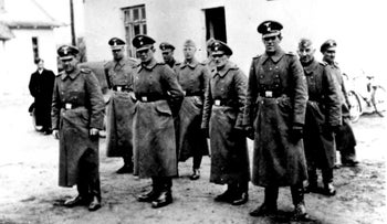 Nazi guards at the Belzec death camp, where 430,000 Jews were murdered, in occupied Poland in 1942