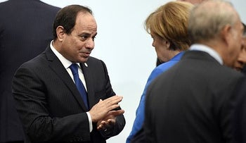 Egyptian president Abdel-Fattah al-Sissi talks with German Chancellor Angela Merkel during the COP21 United Nations Climate Change Conference, in Le Bourget on November 30, 2015.