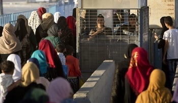 Palestinians waiting at the Qalandiyah checkpoint in the West Bank.