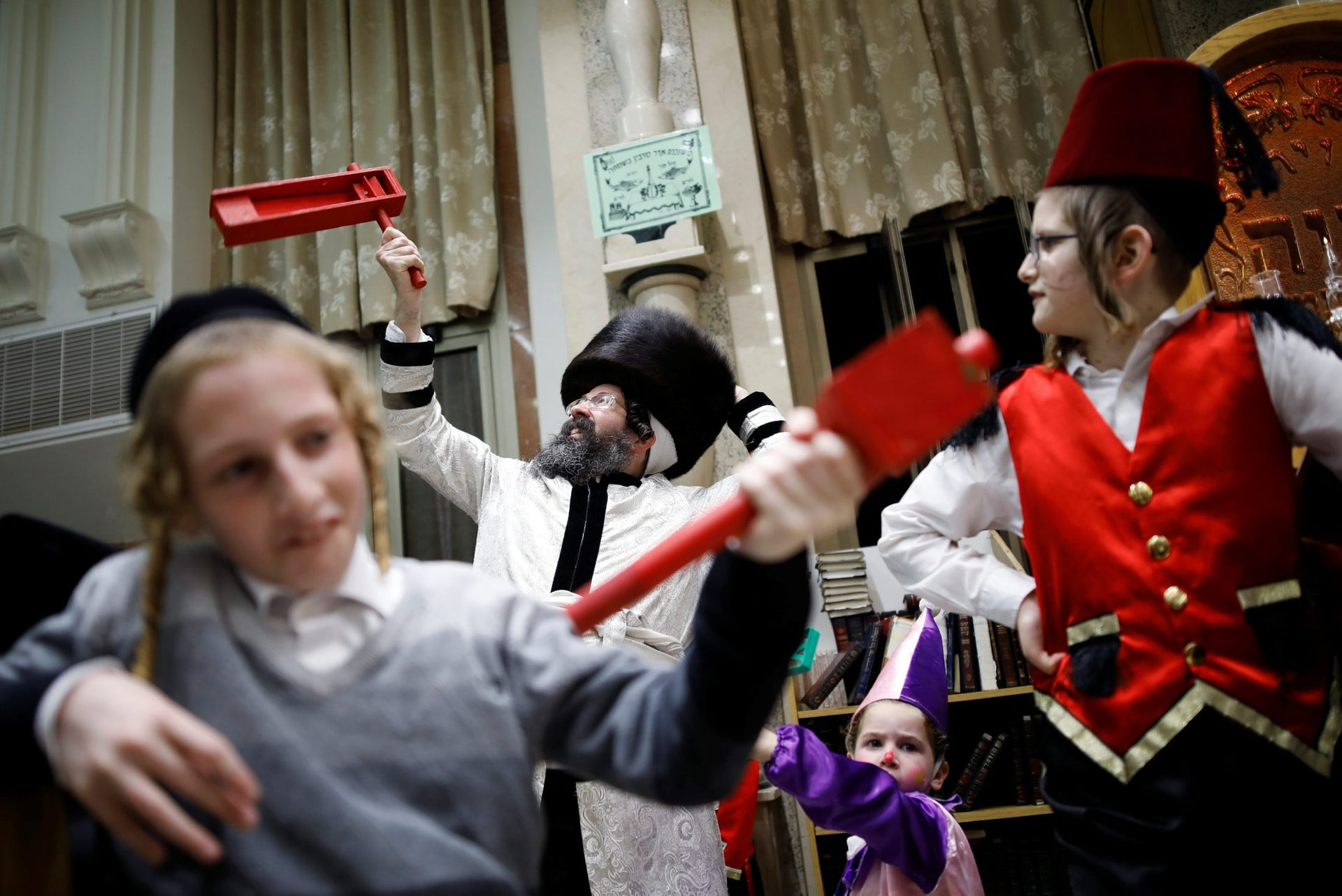 Ultra-Orthodox Jews take part in the reading from the Book of Esther, a ceremony performed on the Jewish holiday of Purim, in a synagogue in Ashdod, Israel, February 28, 2018.