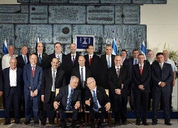Israel's 34th government, with the women edited out. From Hamichlol.