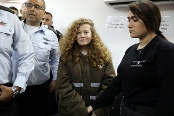 Palestinian teen Ahed Tamimi enters a military courtroom  at Ofer Prison. January 15, 2018.