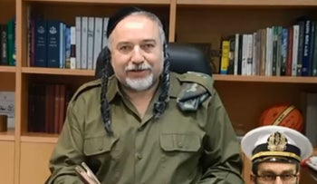Israeli Defense Minister Avigdor Lieberman in an ultra-Orthodox costume in a video posted on his Facebook page.