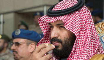 Saudi Arabia's Crown Prince Mohammed bin Salman drinks coffee during the graduation ceremony of the 93rd batch of the cadets of King Faisal Air Academy in Riyadh, February 21, 2018.
