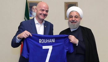 FIFA President Gianni Infantino and Iranian President Hassan Rohani in Tehran, March 1, 2018.