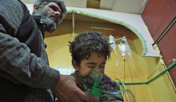Syrian children and adults receive treatment for a suspected chemical attack at a makeshift clinic on the rebel-held village of al-Shifuniyah in the Eastern Ghouta region on the outskirts of the capital Damascus late on February 25, 2018