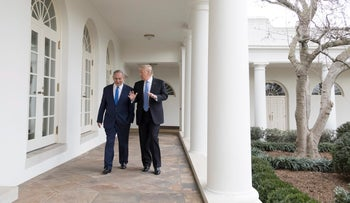 U.S. President Donald Trump and Prime Minister Benjamin Netanyahu walk along the Colonnade at the White House, February 15, 2017.