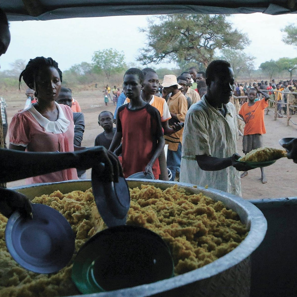 Refugees from South Sudan receive a warm meal on arrival at Bidi Bidi refugee resettlement camp near the border with South Sudan, in Yumbe district, northern Uganda, December 7, 2016.