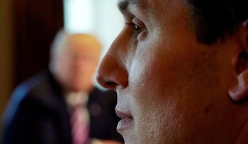 White House senior adviser Jared Kushner listens as U.S. President Donald Trump holds a meeting on trade with members of Congress at the White House in Washington D.C. February 13, 2018