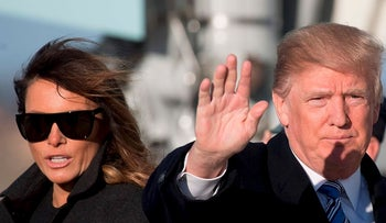 U.S. President Donald Trump and First Lady Melania Trump walk off Air Force One at Andrews Air Force Base, Maryland, on March 3, 2018