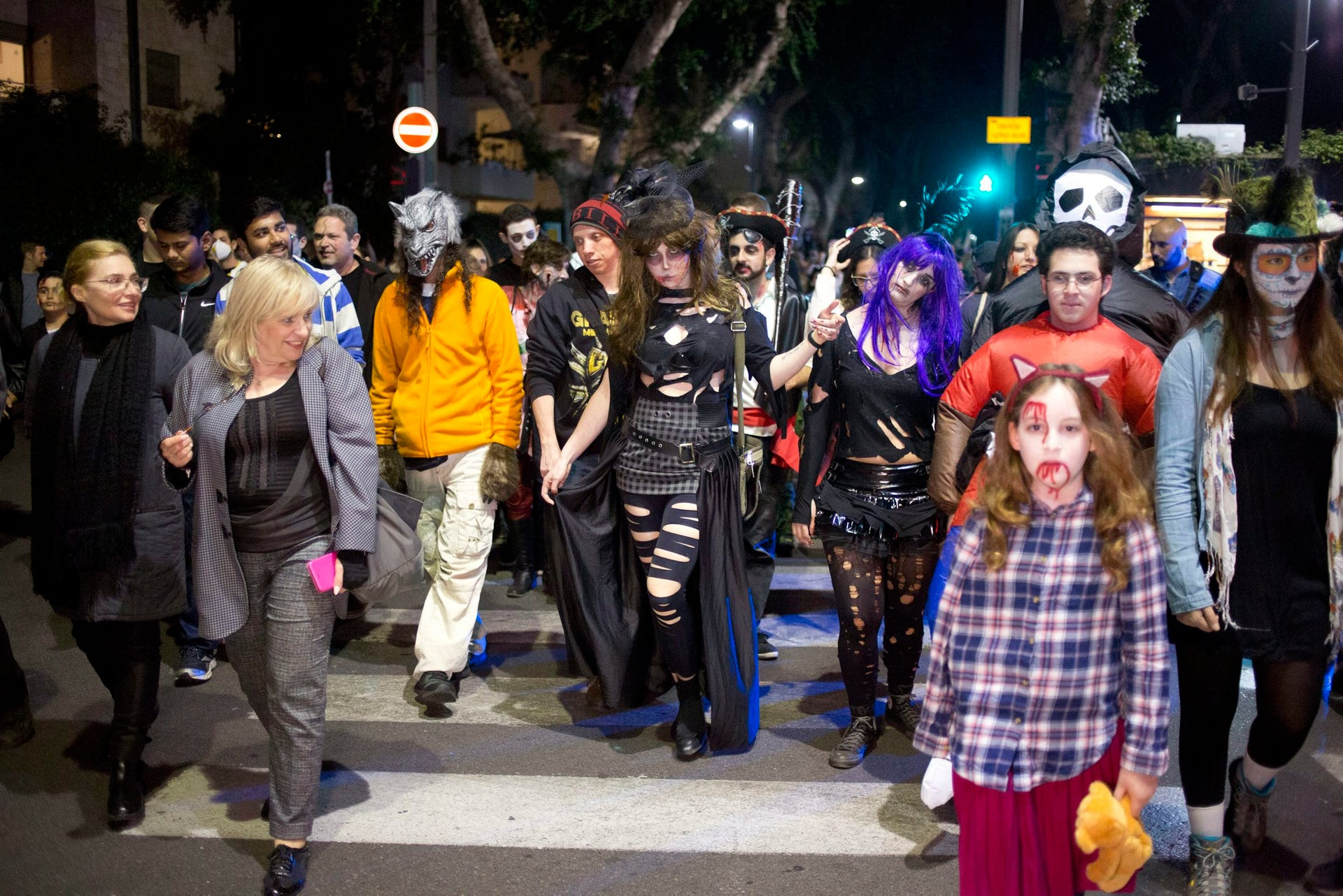 People wear zombie make-up and outfits in the Zombie Walk during the Purim festival in Tel Aviv, Israel, Saturday, March 3, 2018.