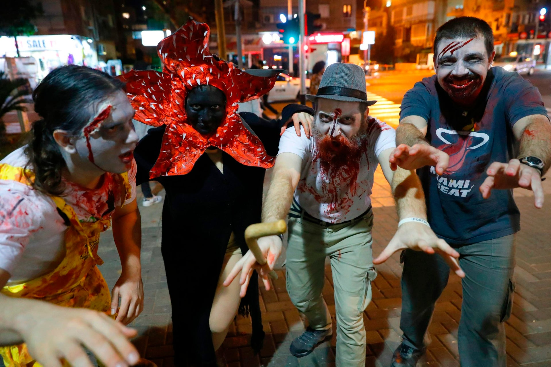 "People wearing costumes and face paint pose as they take part in a ""Zombie walk"" in Tel Aviv as part of the Jewish holiday of Purim on March 3, 2018."