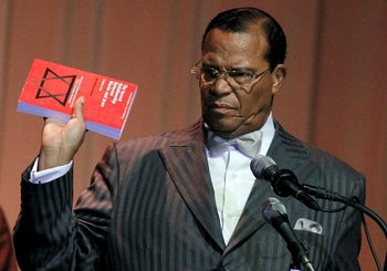 """In this file photo, Louis Farrakhan displays the book, """"The Secret Relationship Between Blacks and Jews,"""" during his speech Friday, March 25, 2011 at Jackson State University in Jackson, Miss."""
