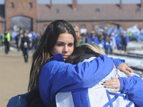 Young people hug each other during the March of the Living in Oswiecim, Poland. April 8, 2013.
