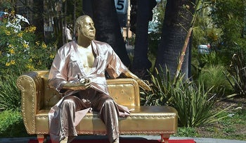 A gold sculpture of Harvey Weinstein on his infamous casting couch holding an Oscar statue is on display in Hollywood, California on March 1, 2018