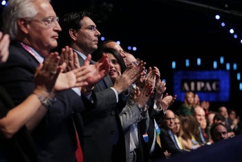 U.S. Ambassador to Israel David Friedman stands next to Israel's UN ambassador Danny Danon and Israeli Justice Minister Ayelet Shaked to welcome U.S. Vice President Mike Pence addressing AIPAC. March 5, 2018.