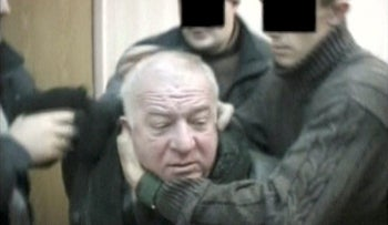 A still image taken from an undated video shows Sergei Skripal, a former colonel of Russia's GRU military intelligence service, being detained by secret service officers in an unknown location. RTR/via Reuters TV ATTENTION EDITORS - THIS IMAGE HAS BEEN SUPPLIED BY A THIRD PARTY. RUSSIA OUT. NO COMMERCIAL OR EDITORIAL SALES IN RUSSIA. NO RESALES. NO ARCHIVE. DIGITAL: NO ACCESS RUSSIA. FOR REUTERS CUSTOMERS ONLY.