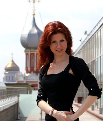 """Anna Chapman, the former Russian spy, poses for a photograph against the Moscow skyline following an interview at an office in Moscow, Russia, on Friday, June 3, 2011. """"I've always been fascinated with technology,"""" Chapman, 29, said in an interview in Bloomberg News' Moscow office yesterday. Photographer: Andrey Rudakov/Bloomberg"""