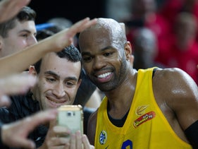 American basketball player Alex Tyus and Israeli fans during a game in 2017.