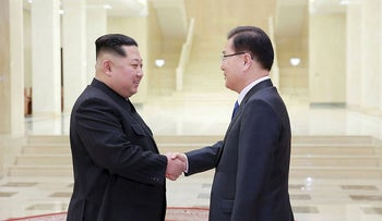 This picture taken on March 5, 2018 and released from North Korea's official Korean Central News Agency (KCNA) on March 6, 2018 shows North Korean leader Kim Jong-Un (L) shaking hands with South Korean chief delegator Chung Eui-yong (R)
